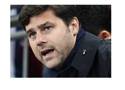 Tottenham Hotspur manager Mauricio Pochettino in action during the game.  Wearing a black coat.