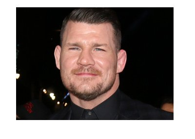 The spotlight is on the current welterweight UFC champion - Michael Bisping.  The champ is wearing a dark suit.