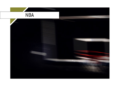 The Basketball board photographed in a dark arena.  NBA 2018/19 season.  Who is the next coach in line to be fired?