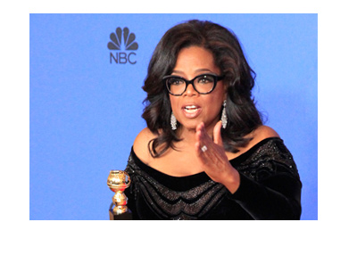 Oprah Winfrey at the NBC Golden Globe Awards 2018.  Holding her prize.