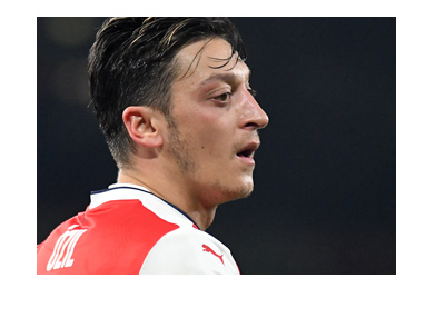 Ozil is breathing heavy.  The Game is on.  2016-17 season. Arsenal home kit.