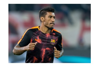 Barcelona attacker, Paulinho, wearing the team away kit used in the Champions League.  Year is 2017.  Serious focus.