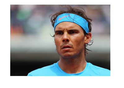 Rafael Nadal photographed at the French Open tennis tournament.  Deep focus.