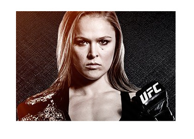 Ronda Rousey representing UFC.  Glove up.  Serious.
