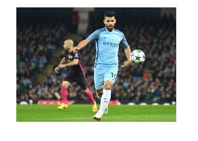 Manchester City striker, Sergio Aguero, in action.  About to take a shot.
