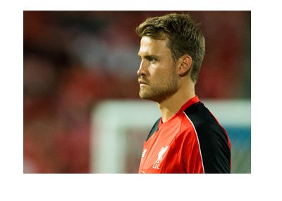 Simon Mignolet of Liverpool FC - Action profile from the side.