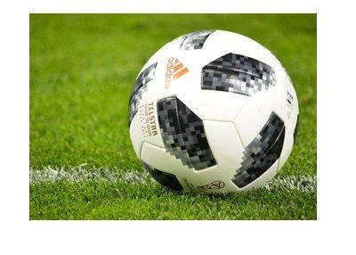 The Telstar World Cup ball on grass - Russia 2018.