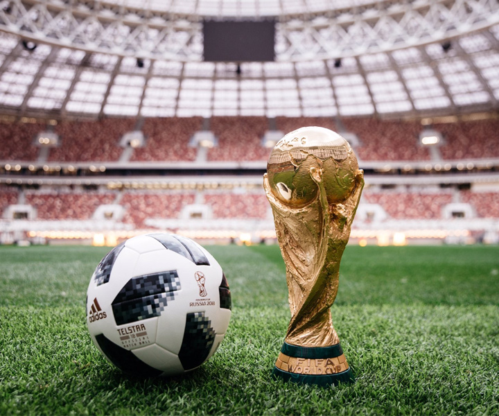 The 2018 World Cup in Russia official ball - Telstar 18 - Photographed next to the World Cup trophy at the Luzhniki Stadium in Moscow.
