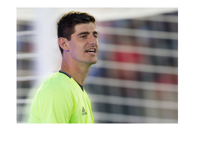 Chelsea FC goalkeeper Thibaut Courtois in training.  Wearing a yellow top.