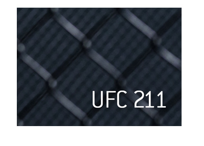 UFC 211 text over octagon cage mesh.
