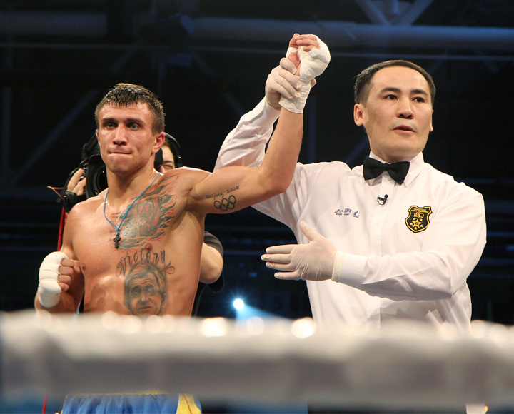 Archive photo of the victorious Vasyl Lomachenko.  Hand is held up by the referee after the match.