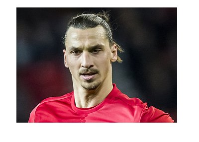 Zlatan Ibrahimovic sporting the Manchester United bright red home kit.  Year is 2017.  Signature pose.