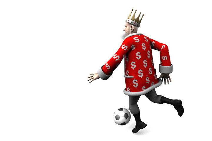 The King is performing a close-control move in the game of football.