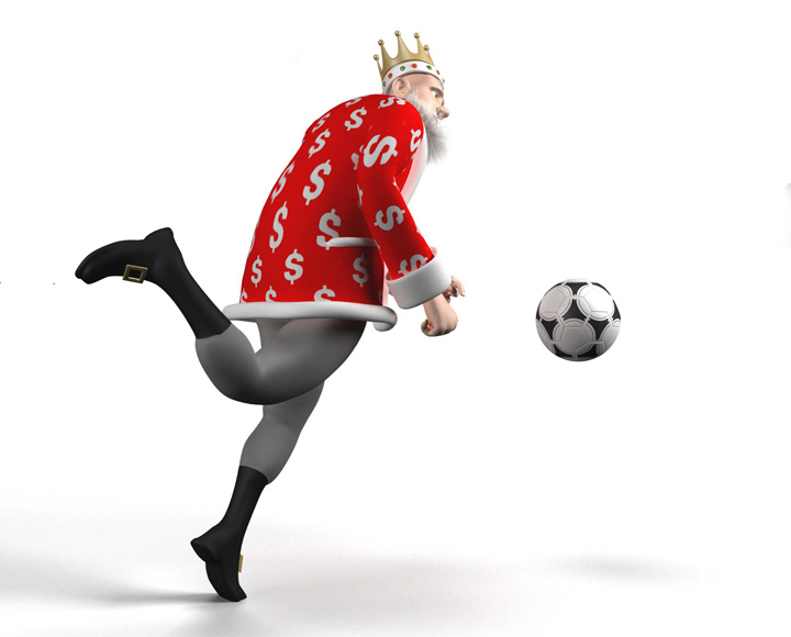 The King is about to kick the approaching soccer ball.  Igra fuce.  Football